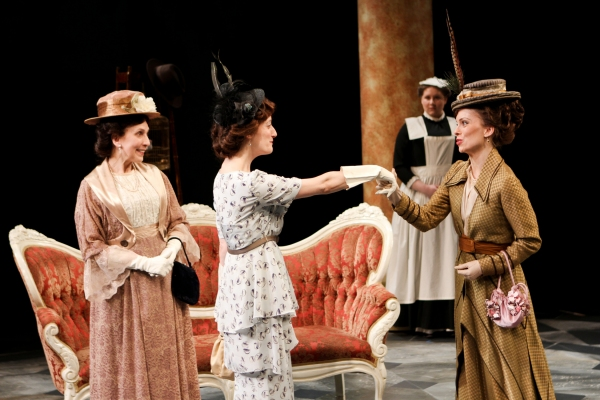 Marty Mukhalian as Mrs. Eynsford-Hill, Jennifer Lee Taylor as Eliza Doolittle, Aimee Filippi as a maid, and Amy Hill as Clara Eynsford-Hill