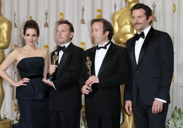 Tina Fey and actor Bradley Cooper pose with Eugene Gearty (second from left) and Philip Stockton (second from right), winners of the Sound Editing Award for 'Hugo'