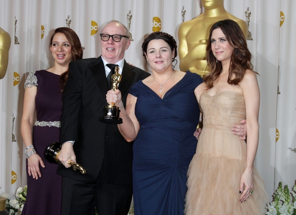 Maya Rudolph, filmmakers Oorlagh George and Terry George, and actress Kristen Wiig