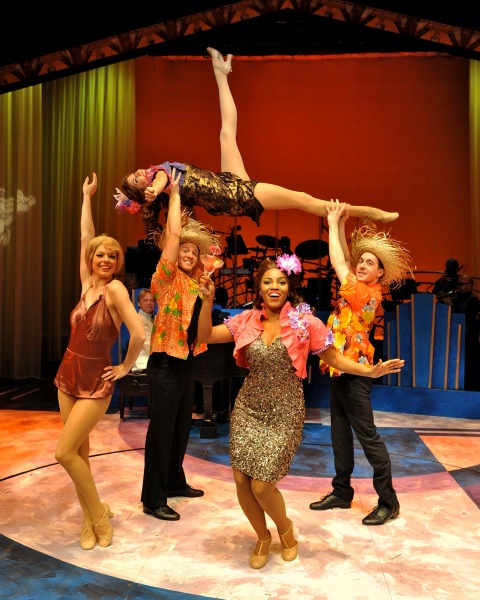 Sean Watkins, Stacey Harris (in the air), Blakely Slaybaugh and Mary Millben Photo
