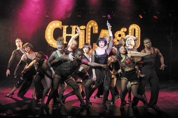 "Lindsey Roberts (center)portrays murderess Velma Kelly in the Theatre Memphis production of Chicago, March 9 �"" April 1, 2012. She is surrounded by the company chorus during the production number ""All That Jazz."""