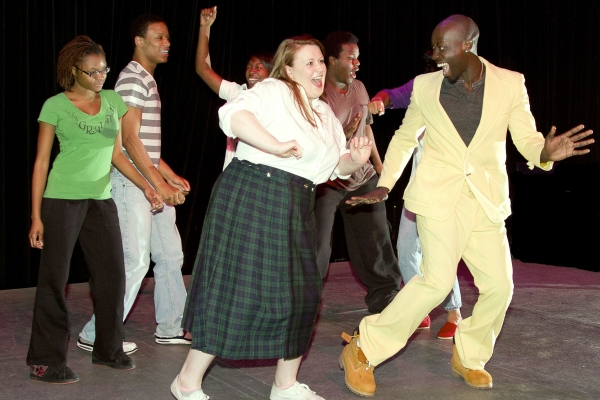 Kristen Kane of Plainsboro as Tracy Turnblad and Tommy Thomas of Georgetown, England as Seaweed J. Stubbs.  In back, from left are ensemble members Nilah Montgomery, Adiin Clemons, Domonique Jarrett and Maleek Colvin.