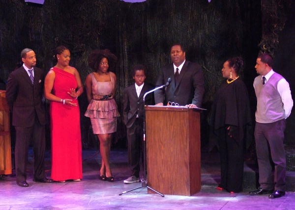 Wren T. Brown of Ebony Repertory Theatre accepts the McCulloh Award for Revival for A Raisin in the Sun, with members of the company.