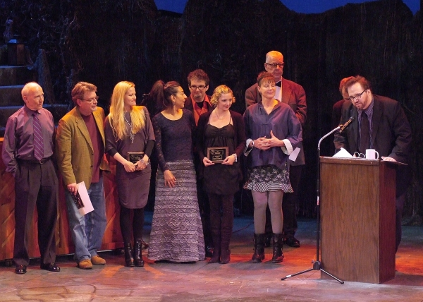 Bart DeLorenzo of Evidence Room accepts the Production Award for Margo Veil, with members of the company.