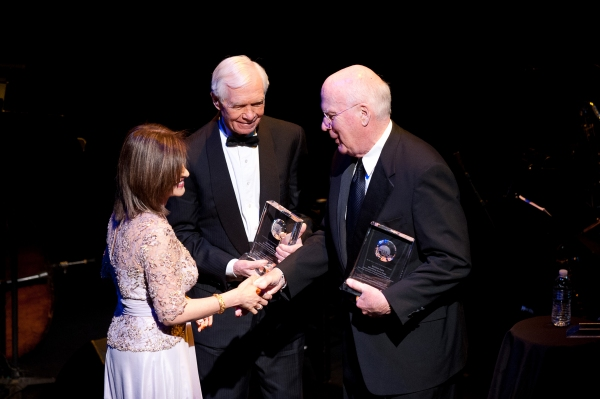 Kay Kapoor, of Accenture Federal Services, presents the American Voice Awards to senators Thad Cochran and Patrick Leahy