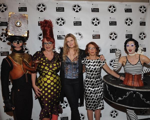 Cirque du Soleil's Iris characters pose with Jazz singer Tierney Sutton (Center-Left) and Cirque du Soleil's Iris Artistic Director Denise Biggi (Center-Right)