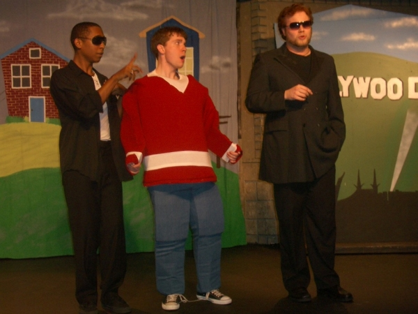 Jordan C. Allen as the Hollywood Assistant, Matthew Crawford as Flat Stanley, and Jordan       Stocksdale as the Hollywood Agent at 'FLAT STANLEY' at Way Off Broadway Children's Theatre