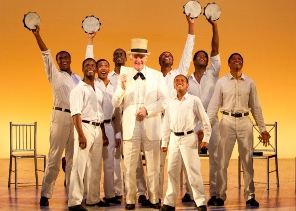 Ron Holgate as The Interlocutor (center) and the Cast of The Scottsboro Boys