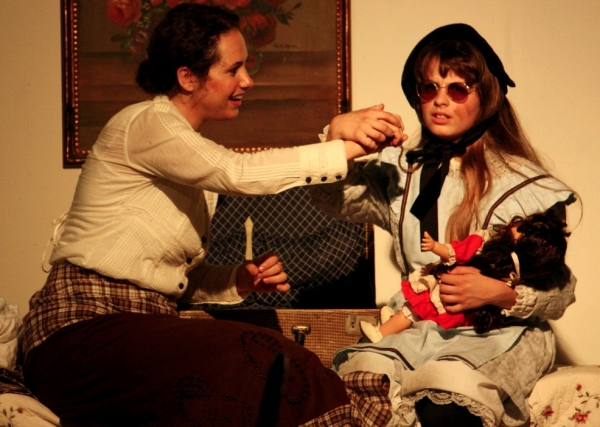 Annie (Faith Streng) begins teaching Helen (Francesca Farina)