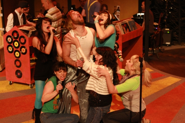 Laura (Kimi Short, center) and the Ex-Girlfriends surround Ian (Aaron Allen) at Production Pics from New Line Theatre's HIGH FIDELITY