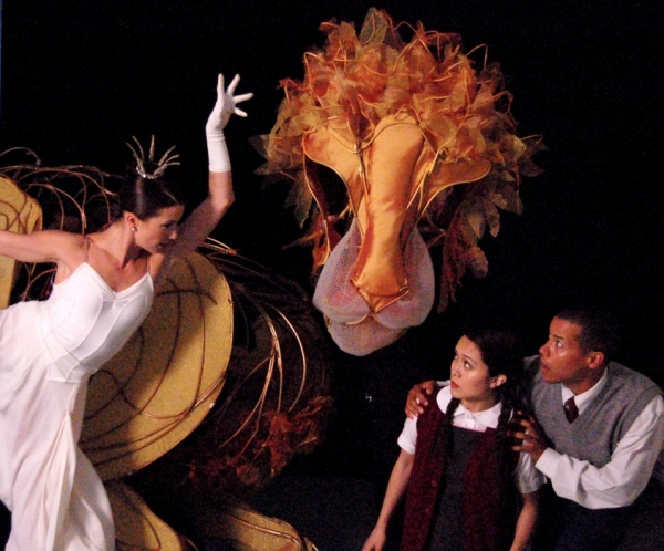 The White Witch (Morgann Rose), Aslan (portrayed by Michael John Casey, Betsy Rosen, and Tracy Ramsay), Lucy (Justine Moral), and Edmund (Rafael Cuesta)