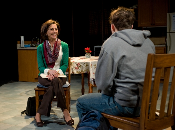 Kate Deckhouse (Janet Ulrich Brooks) speaks with Paulie (Joey deBettencourt), one of her students