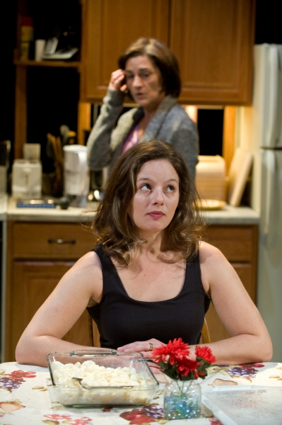 Kate Deckhouse (Janet Ulrich Brooks) shares an awkward pause with Amy (Nicole Wiesner)