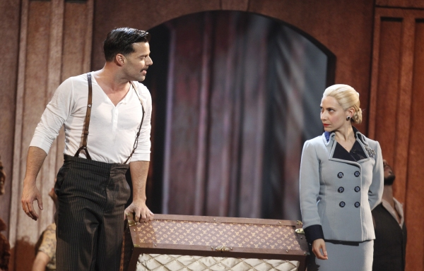 "Elena Roger from the play ""Evita"" performs with singer Ricky Martin"
