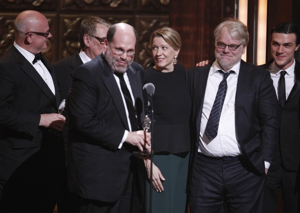 "Philip Seymour Hoffman (2nd R) and producers of ""Death of a Salesman"" accept a Tony award for best revival of a play"
