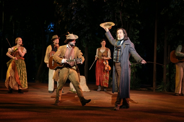 Jordan Tice and Stephen Spinella (foreground) in the Shakespeare in the Park production of As You Like It, directed by Daniel Sullivan, running as part of The Public Theater's Shakespeare in the Park season celebrating 50 years at The Delacorte in Central
