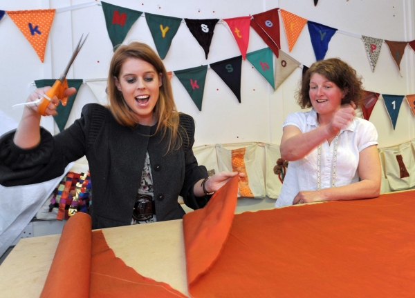 HRH Princess Beatrice successfully tries her hand at pattern cutting as she scissors her way through material for an angel costume