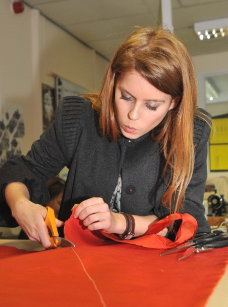 HRH Princess Beatrice tries her hand at pattern cutting as she scissors her way through material for an angel costume at the York Mystery Plays' costume workshop