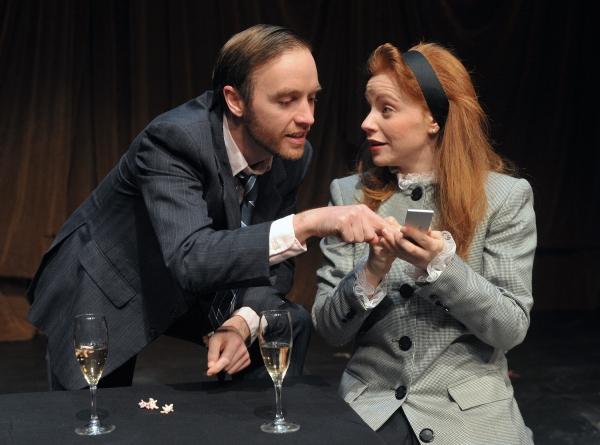 James O. Dunn as Grimes and Tara Giordano as Scilla Todd in Serious Money Photo
