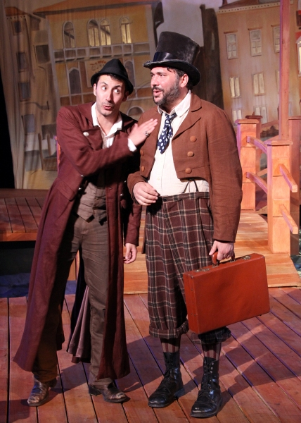 Philip Mutz as Antipholus of Ephesus schemes a plan with Angelo the goldsmith played by Jay Leibowitz