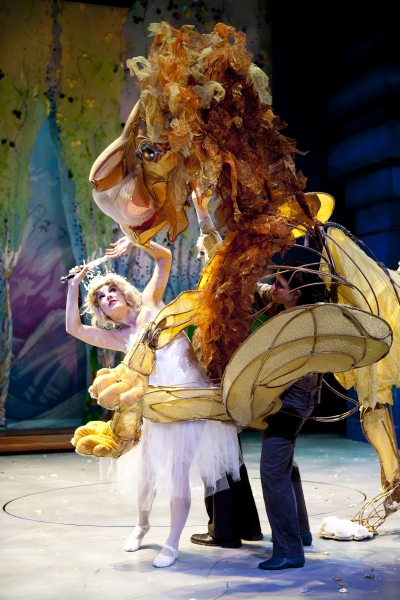 Aslan (puppeteers Michael John Casey, Betsy Rosen, Tracy Ramsay) fights the White Witch (Morgann Rose).