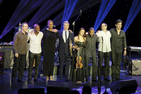 Chris Botti with his team of musicians: vocalist Lisa Fischer, guitarist Leonardo Amuedo, drummer Billy Kilson, bassist Richie Goods, violinist Aurica Duca, pianist Geoffrey Keezer, and keyboardist Andy Ezrin. at Chris Botti Live in Concert