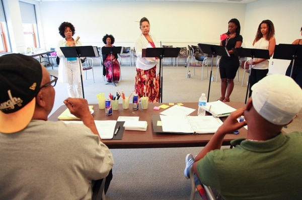 Marion McClinton and Marcus Gardley (foreground) and Denise Burse, Harriett D. Foy, Lynda Gravatt, Saycon Sengbloh, and Tracie Thoms (background)