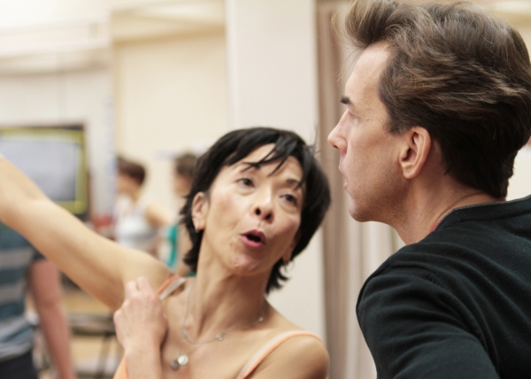Choreographer JoAnn Hunter walks Michael Andrew through a dance number.