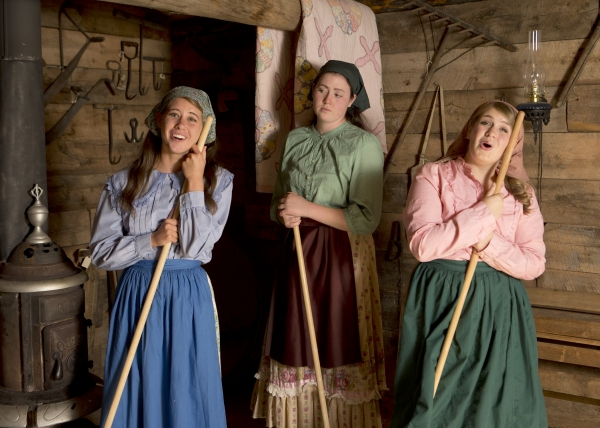 Hannah Herring as Tzeitel (green top), Katie Abbott as Hodel (blue top) and Emily Erdmann as Chava (pink top)